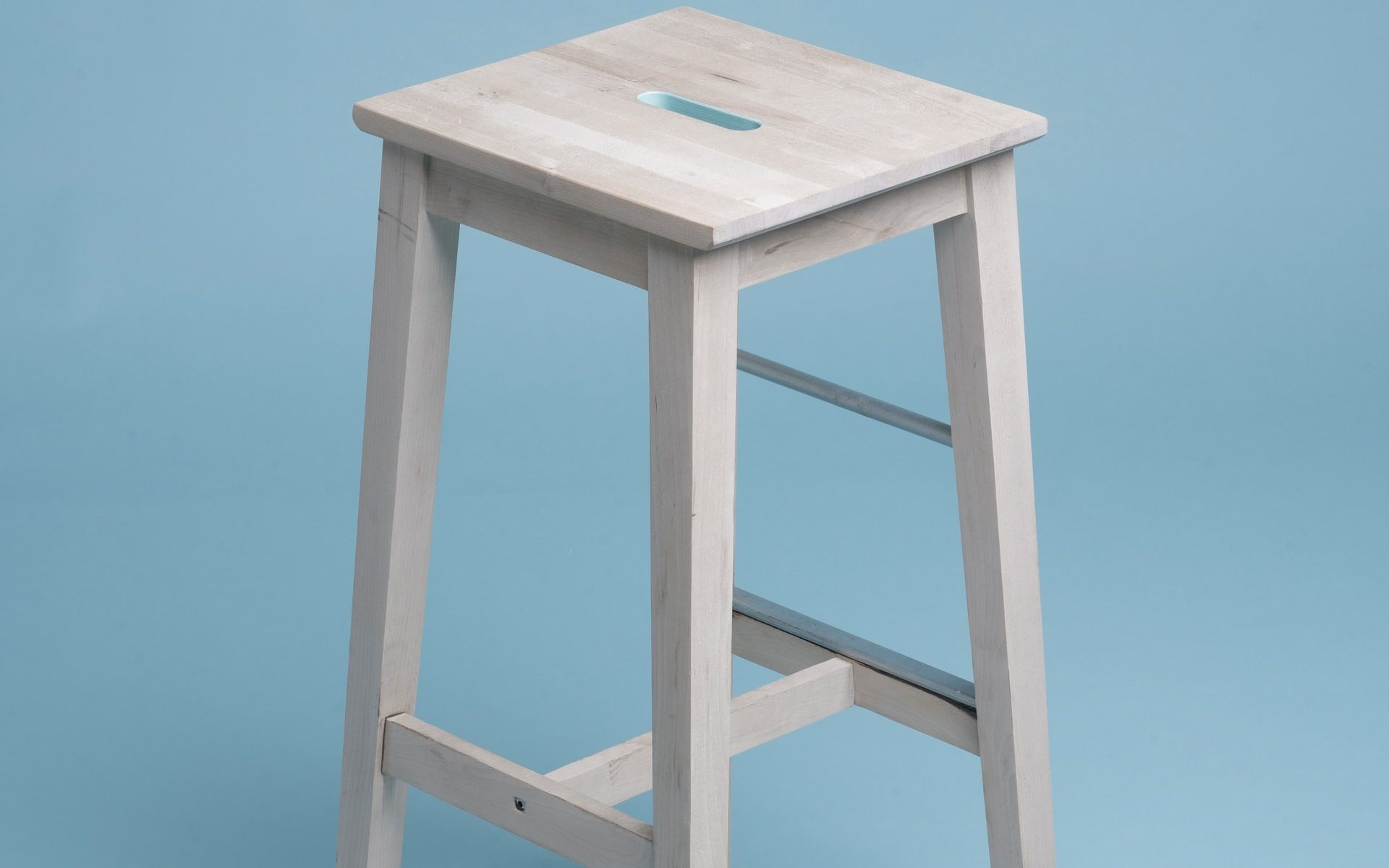 wooden chair on blue background